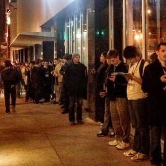 *Lines stretched around the Paramount Theater;* the marquis premiere drew in crowds hours before its premiere